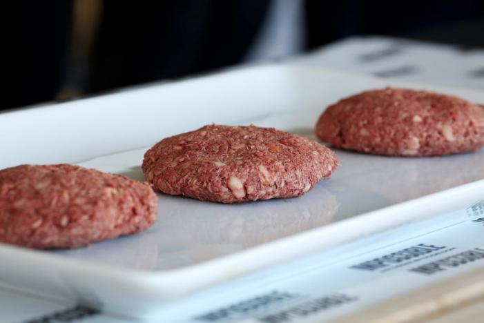 Plant-based hamburger patties are on display during a media tour of Impossible Foods labs and processing plant in Redwood City, California